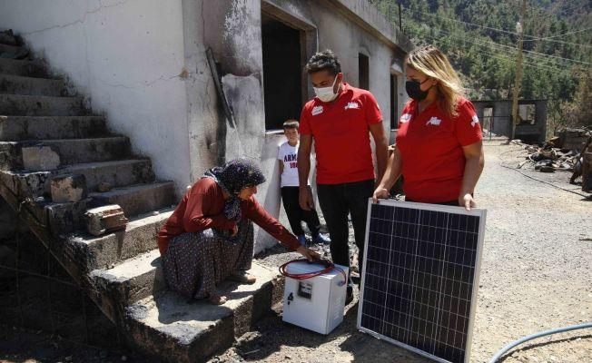 Yangından etkilenen afetzedelere güneş paneli sistemi dağıtıldı